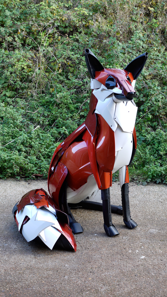 A fox made from old car bumpers